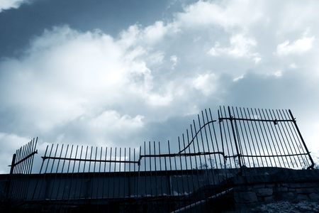 Old gate with open sky and clouds Stock Photo - 764251
