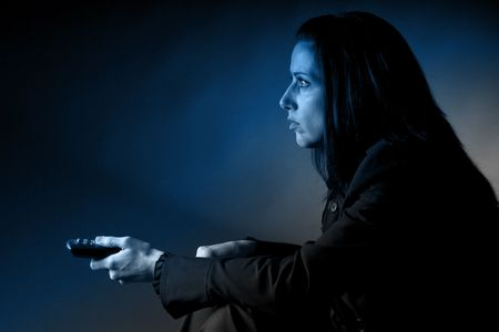 Woman watching TV photo