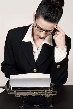 Retro business woman with vintage typewriter