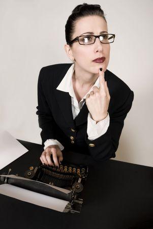 writers block: Retro business woman with vintage typewriter