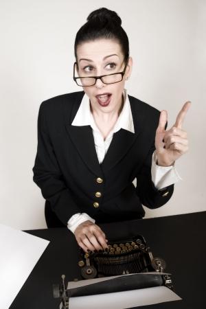 Retro business woman with vintage typewriter photo
