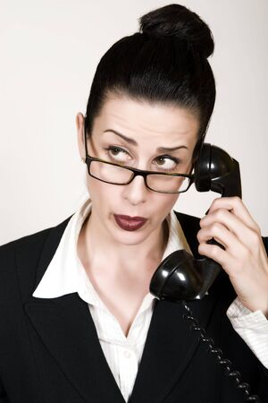 Retro business woman with vintage phone making a call photo