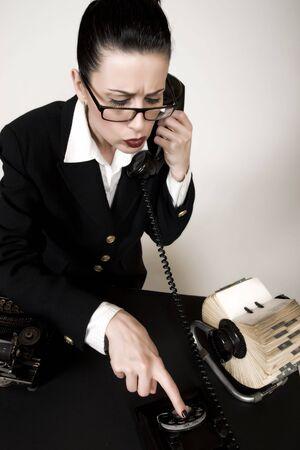 retro woman: Retro sales woman making calls on vintage phone Stock Photo