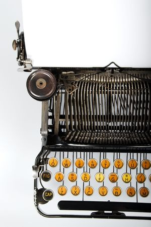 Close-up of vintage retro typewriter with blank sheet of paper photo