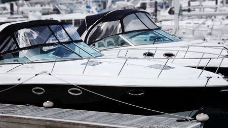 speedboats: Close-up of two luxury speedboats parked in harbor