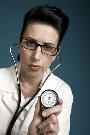Retro styled medical professional showing high blood pressure results Stock Photo - 2047194