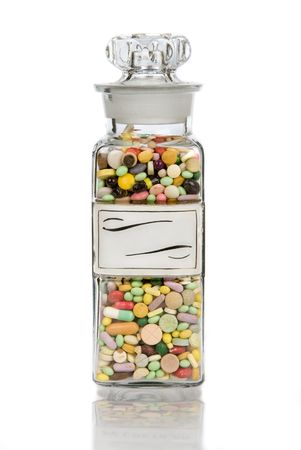 A vintage glass full of pills with blank retro label Stock Photo - 2047199