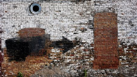 gritty: Old weathered urban wall with bricked up window and door Stock Photo