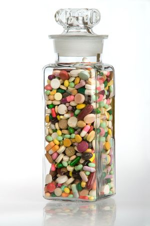 A vintage glass full of pills and capsules Stock Photo - 2101105