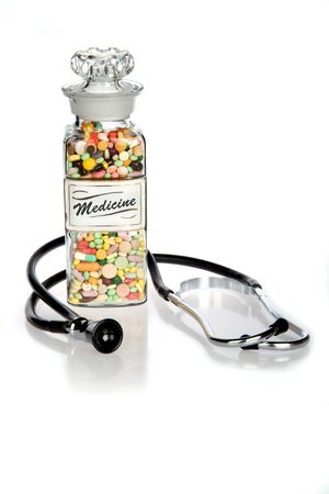 Retro medical concept featuring antique pill bottle and old stethoscope Stock Photo - 2101103