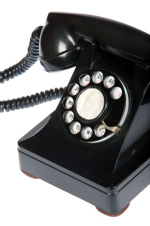 Close-up of vintage retro rotary telephone on white background