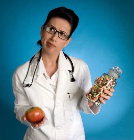 health care professional: Retro styled female health care professional holding an apple and a classic oversized bottle of pills