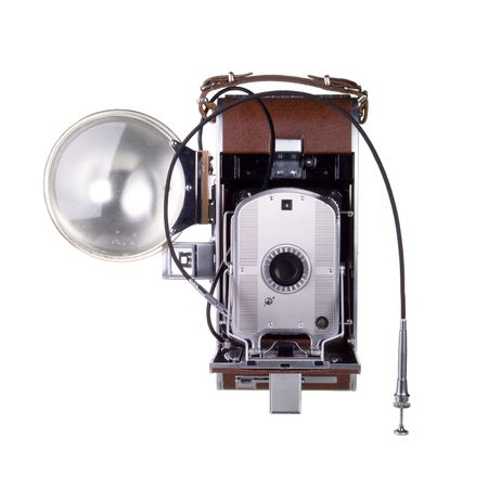 Vintage instant film camera with flash and cable release