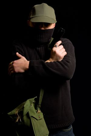 Disguised gunman crossing his arms photo