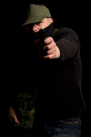 Disguised gunman pointing handgun in your face photo