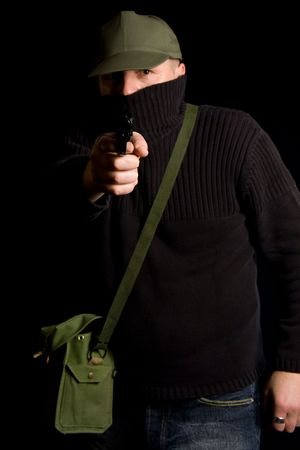 Disguised gunman pointing handgun in your face Stock Photo