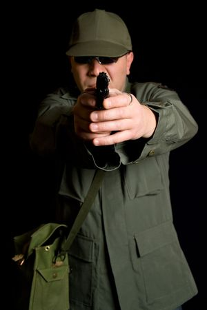 con man: Disguised military gunman pointing handgun in your face