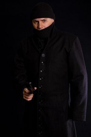 punisher: Disguised gunman in long black coat