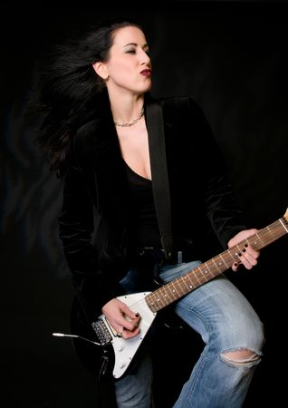 Female lead guitarist with electric guitar