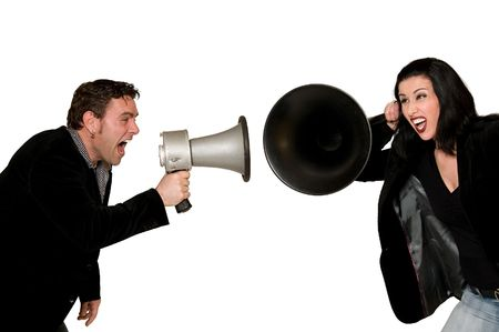 Man screaming with megaphone at woman listening with huge hearing aid photo