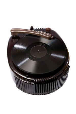 Retro vintage turntable isolated on white background photo