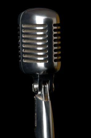 Retro microphone close-up on black background photo