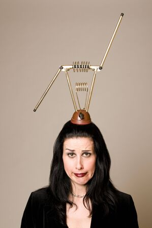 retro tv: Woman with retro antenna on her head looking confused