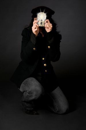 Retro style female photographer with vintage camera and flash photo