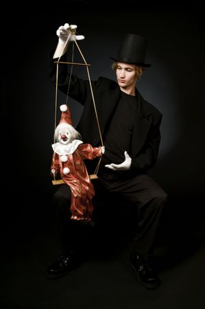 puppet theatre: Performing artist with clown marionette