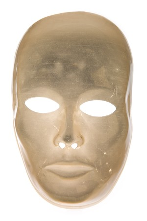 Eerie translucent scratched golden face mask isolated on white background photo