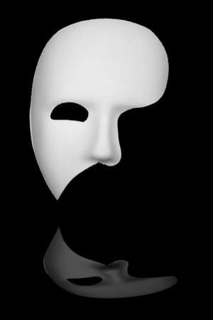 alter ego: White phantom of the opera half face mask isolated on black background
