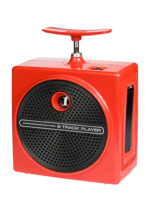 Retro red portable eight track tape player isolated on white background photo