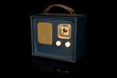 Vintage retro portable radio isolated on black background Stock Photo - 4089859