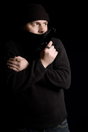 con man: Gunman watching and waiting for action Stock Photo