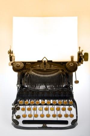 Vintage retro typewriter with blank white sheet on gradient background