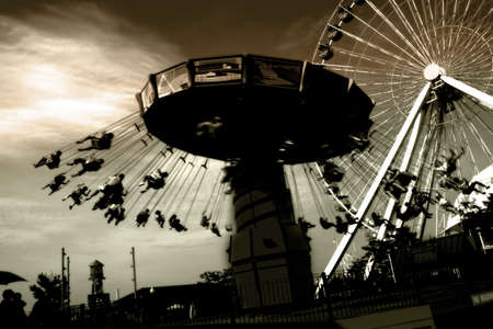 Amusement park with ferries wheel and carousel at night photo