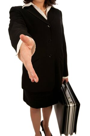 greeting people: Business woman with briefcase offering a handshake Stock Photo