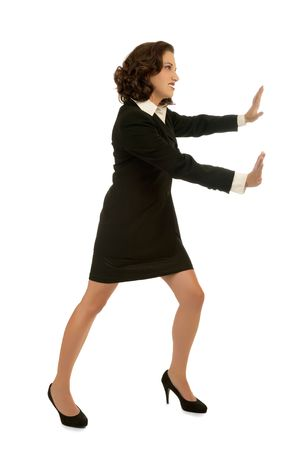 Young attractive business woman moving an invisible object photo