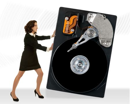 Young attractive business woman moving a hard drive