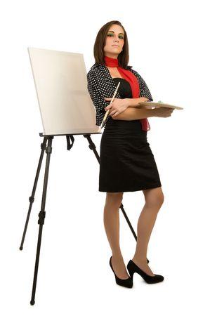 Young female artist posing next to a blank canvas Reklamní fotografie