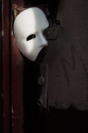 theatre masks: Masquerade - Phantom of the Opera Mask on Vintage Door Stock Photo