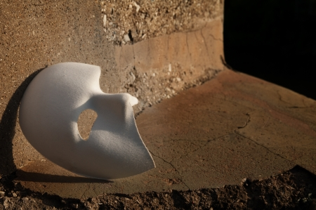 Masquerade - Phantom of the Opera Mask on Cracked Stone Stock Photo - 14206436