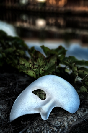 theatre costumes: Masquerade - Phantom of the Opera Mask on Vintage Bridge Stock Photo