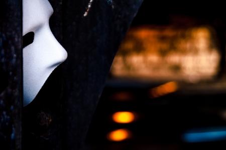 Lurking in the Shadows - Phantom of the Opera Mask in Dark Tunnel Stock Photo