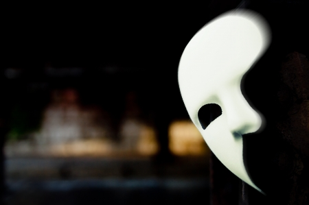 theatre masks: Lurking in the Shadows - Phantom of the Opera Mask in Dark Tunnel Stock Photo