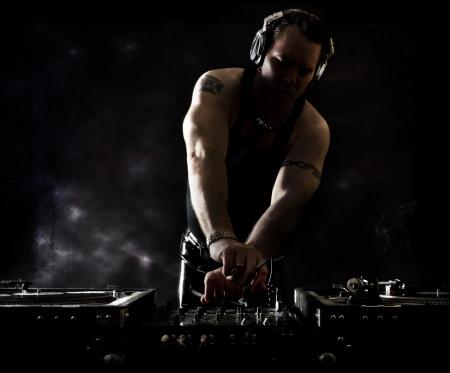 disc jockey: Dark Beats - DJ Mixing Stock Photo