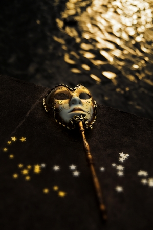 Masquerade - Venetian Mask by the River Stock Photo