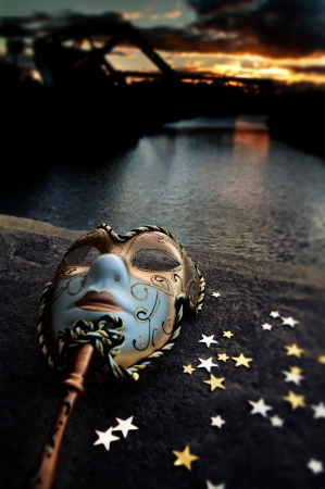 Venetian Mask by the River Bridge with Sunset Stok Fotoğraf
