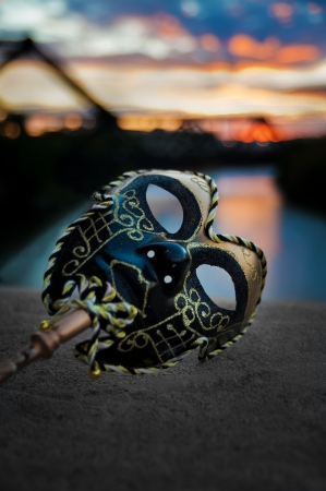 Venetian Mask by the River Bridge with Sunset Stock Photo - 15534846