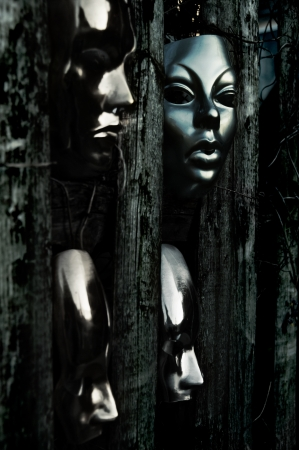 Trapped - Masks behind Weathered Fence photo